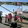 Photo by Greg Eans, Messenger-Inquirer.com/geans@messenger-inquirer.com<br /> <br /> Erin Bliss Thompson of Shepherdsville, left, chairwoman of the Bluegrass Chapter of Ninety-Nines, an international organization for women pilots, gives a presentation about her experimental 120A Sport homebuilt airplane to a group of girls during the first Girls Aviation & Aerospace Day Camp at the Owensboro-Daviess County Regional Airport.