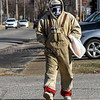 Photo by Greg Eans, Messenger-Inquirer | geans@messenger-inquirer.com<br /> <br /> Clarence Davis, Jr., of Owensboro, bundles up in the cold weather as he walks along E. 18th Street. Davis brought his coffee thermos with him as he spent the day walking to run errands around town.