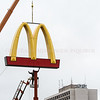 "Photo by Greg Eans, Messenger-Inquirer.com/geans@messenger-inquirer.com<br /> <br /> Jeremy Warren of Derby City Sign & Electric out of Louisville works on a lift while attaching a McDonald's restaurant ""Golden Arches"" sign atop a 40-foot pole at the location of the new McDonald's at 2750 Frederica Street in Wesleyan Park Plaza."