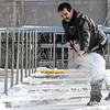 Photo by Greg Eans, Messenger-Inquirer | geans@messenger-inquirer.com<br /> <br /> Wayne Finley with the Owensboro Convention Center clears snow from a section of the steps at the entrance to the facility in Owensboro. Finley was with a team of workers that were clearing the snow and plowing the parking lot.