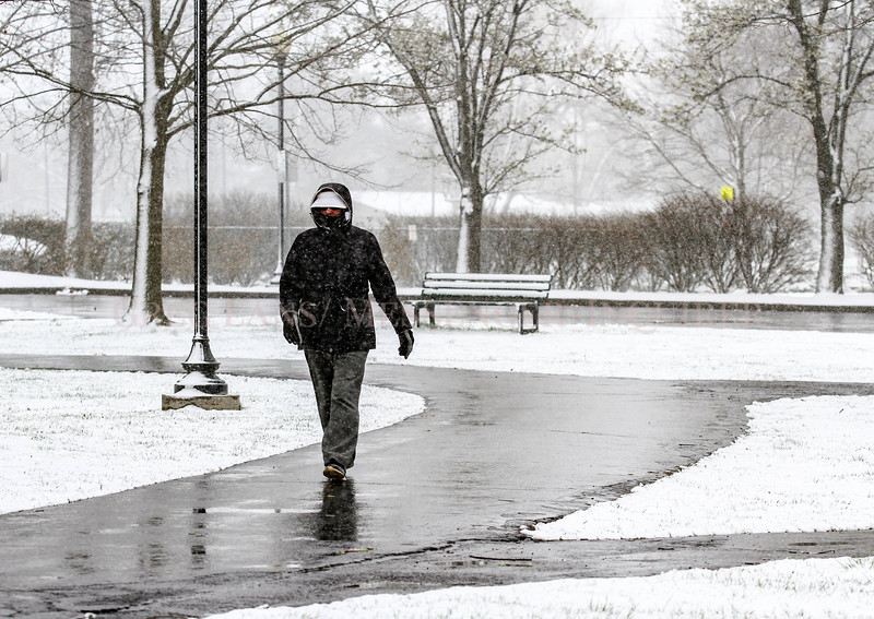 "Photo by Greg Eans, Messenger-Inquirer.com | geans@messenger-inquirer.com<br /> <br /> Terry Coffman of Owensboro bundles while taking an early morning walk in the snow at Legion Park. ""If you wear layers it's not so bad,"" Coffman said. ""I get out and walk three miles every morning."""