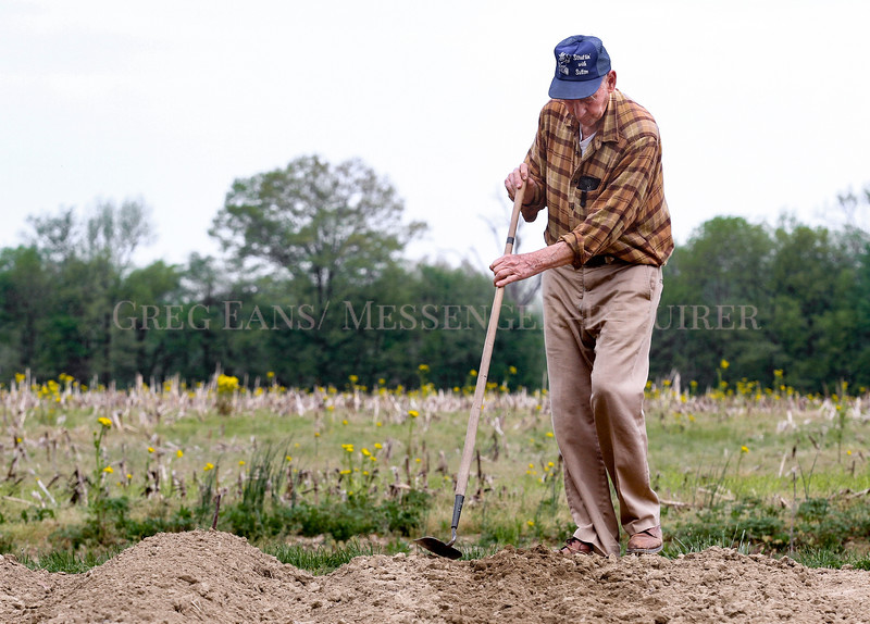 Photo by Greg Eans, Messenger-Inquirer.com | geans@messenger-inquirer.com<br /> <br /> Kenneth Drochter works with a hoe, covering a row of freshly planted butter bean seeds in his garden on Wayne Bridge Road in Daviess County. Drochter is planting several vegetables this year, including sweet potatoes, potatoes, tomatoes, onions, cucumbers and watermelons.