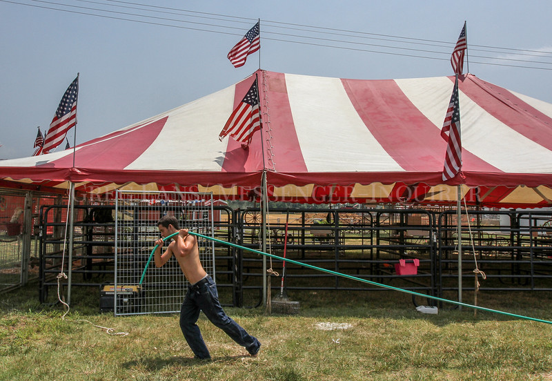 Photo by Greg Eans, Messenger-Inquirer.com/geans@messenger-inquirer.com<br /> <br /> Michial Chosewood of Lovejoy, Georgia prepares to fill water buckets for animals while setting up the All American Petting Zoo for the Daviess County Lions Club Fair at the fairgrounds off of Kentucky 54 in Philpot.