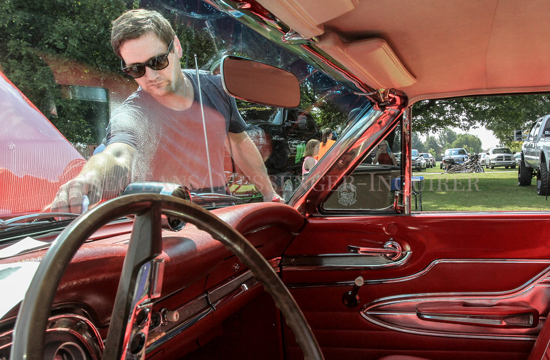 Photo by Greg Eans, Messenger-Inquirer.com/geans@messenger-inquirer.com<br /> <br /> Duncan Smith of Louisville cleans the window of his father in-law's 1963 1/5 Ford Falcon Sprint during the 7th annual Kentucky Wesleyan College All-American Club Classic Car and Truck Show.
