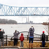 A crowd of onlookers take photographs of the rising level of the Ohio River as it encroaches the barrier wall at Smothers Park on Saturday, Feb. 24, 2018, in Owensboro, Ky. (Greg Eans/The Messenger-Inquirer via AP)