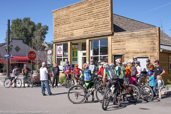 Riders listen while Mayor Yuri Kostick welcomes those taking advantage of a guided local trial ride outside Mountain Pedaler bike shop on Saturday before the race. Photo Leslie Farnsworth-Lee.