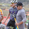 Coach Ben Boyer congratulates Garrett Gerchar (Boulder High School) his 3rd place finish at the end of Boys Varsity Division. Gerchar completes his high school racing career 3rd overall for the 2013 series. Photo Leslie Farnsworth-Lee.