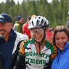 Claire Vandeyacht, Varsity, Summit, celebrates a muddy third place finish with her parents. Photo Austin Smart.