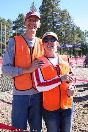 Steve and Sherrie Merrihew, East High parents volunteer at the finish line. Photo Leslie Farnsworth-Lee.