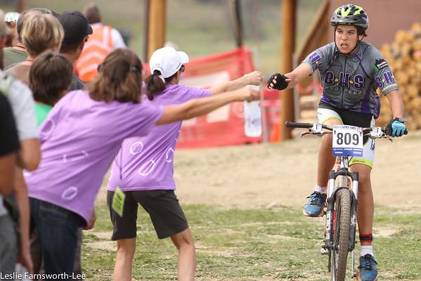 Henry Mans, Boulder High Freshman, receives fresh water bottle. Photo credit Leslie Farnsworth-Lee.