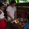 Marlon Langeland and Jhoana are cooking traditional Colombian dinner.<br /> <br /> Jhoana, 20 years old, and her family had to flee after an armed attack in her village. Two of her brothers and her two cousins where killed. All male youth.<br /> <br /> Jhoana grew up in a small village along the river in the region of Chocó, Colombia. She loved playing with her siblings and cousins, walking in the bush and went swimming. Her dream was to study veterinarian because her passion for animals. Her dream got tossed when the community repetitively was threatened and they eventually had to flee.<br /> <br /> Armed attack<br /> It was an ordinary day in March 2017 when Jhoana and other women were celebrating women's day. The remaining village, mostly males, continued their normal activities when all of a sudden an armed group attacked. That night Jhoana couldn't sleep due to nightmares and not knowing the extent of the attack and not being able to go back to the village before the next day.<br /> <br /> The next day they witnessed several dead and wounded youths and she was devastated. Not one, but two of her elderly brothers had lost their lives. One where tied up and the other one was laying dead on a rooftop with rain poring down on the body. Furthermore, two cousins and a family friend, all young, and all males also lost their life's. <br /> <br /> Today, the village is abandon and appears more like a ghost town. Jhoana and her family are now too afraid to return to their village because of the uncertainty that follows and if another armed attack will happen again.<br /> <br /> Life today<br /> Now, her daily activities are restricted to short trips; when she leaves the house, she does not go far and she coordinates her trips with relatives. A common daily activity can consist of meeting her cousins at the pier and watch them swim. Or, she will only hang out in their house. At home, where she spends most of her time, she writes her diary to cope with the armed attack and