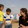 Rebecca Dibb talking with two children in Domiz camp for Syrian refugees in Iraq. Photo Credit: NRC/Ingrid Prestetun