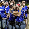 Photo by Greg Eans, Messenger-Inquirer.com | geans@messenger-inquirer.com<br /> <br /> Apollo's Hayden Pulliam, left center, hugs pitcher Payton Blades while surrounded by teammates after winning the 3rd Region softball title game against Grayson County on June 4, 2018 at McLean County High School.