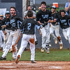 Muhlenberg County High School baseball players celebrate as teammate Noah Phillips crosses home plate with the winning run in the Mustang's walk off win against Daviess County to advance to the championship game of the 3rd Region Baseball Tournament on Wednesday, May 30, 2018, in Hartford, Ky, at Ohio County High School. (Greg Eans/The Messenger-Inquirer via AP)