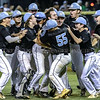 Muhlenberg County High School baseball players storm the field to celebrate around pitcher Brennan Myers after winning the 3rd Region title against Ohio County on Friday, June 1, 2018, in Hartford, Ky. (Greg Eans/The Messenger-Inquirer via AP)