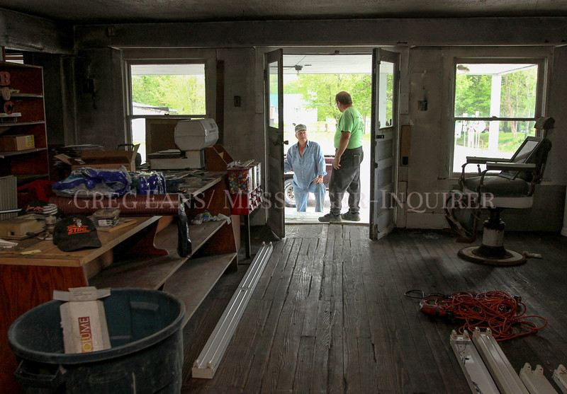 Photo by Greg Eans, Messenger-Inquirer.com/geans@messenger-inquirer.com<br /> <br /> Jack Ferguson, left, stops by to talk with Sam Kravets on the front porch of the old Woosley General Store as Kravets works on renovations inside the building in Rosine. Ferguson, who owns the building, is renting it to Kravets, who plans to turn the store into a museum showcasing bluegrass music and artifacts from the area.