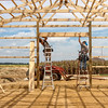 Photo by Greg Eans, Messenger-Inquirer.com/geans@messenger-inquirer.com<br /> <br /> Gary Westerfield, left, and his father, Sam Westerfield, with Roy Westerfield and Sons out of Pleasant Ridge, Ky, frame the opening for an overhead door of a garage that they are building on Hayden Bridge Road on Aug. 30, 2017, in West Daviess County, Ky.
