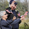 Photo by Greg Eans, Messenger-Inquirer.com/geans@messenger-inquirer.com<br /> <br /> Karen Keoughan and her husband Jim wave American flags as they watch Owensboro's Veterans Day Parade move past them along Veteran's Blvd.