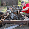 "Photo by Greg Eans, Messenger-Inquirer.com/geans@messenger-inquirer.com<br /> <br /> Jeff Harmon works at removing the engine from the chassis of a 1966 Datsun Roadster in his driveway on Griffith Avenue in Owensboro, Ky.  Harmon is restoring two Datsun Roadsters from the parts of three of the cars. ""It's a beautiful day to get some work done,"" Harmon said."