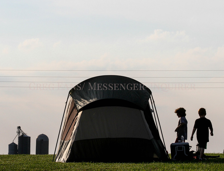 Photo by Greg Eans, Messenger-Inquirer.com/geans@messenger-inquirer.com<br /> <br /> Chase Stiff, 8, left, and his cousin Canyon Pagan, 5, work to pack up their tent after a night of camping at Panther Creek Park with Chase's dad, Brian Stiff. The three were participating in Kids Outdoor Adventure Take a Kid Tent Camping at the park and were also participating in Kids Outdoor Adventure-Take a Kid Fishing Day. Camping programs included Bingo, 4-H programs and a campfire with S'mores provided.