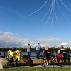 Photo by Greg Eans, Messenger-Inquirer.com/geans@messenger-inquirer.com<br /> <br /> Airshow fans watch from Smothers Park as the Canadian Forces Snowbirds maneuver in formation high above the Ohio River during the Owensboro Air Show in Downtown Owensboro.