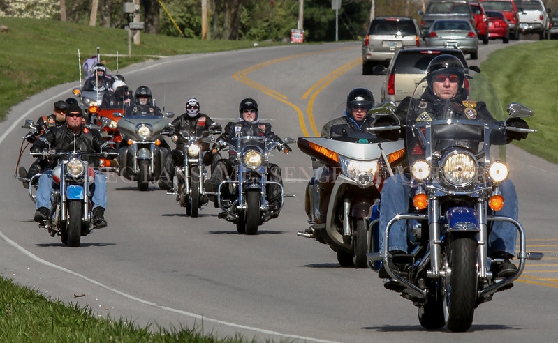 Photo by Greg Eans,Messenger-Inquirer/geans@messenger-inquirer.com<br /> <br /> Members of the Rolling Thunder Kentucky Chapter 1 make their way along Kentucky 54 during a three-mile memorial ride from Franey's Food Mart to the Thruston-Philpot Fire Station on Kentucky 142 while participating in the Sgt. Michael C. Cable Memorial Street Sign Dedication Ceremony at the fire station. Davis County honored Cable, who died in Afghanistan on March 27, 2013, with a ceremony and renaming of Kentucky 142, from Kentucky 54 to U. S. 231.