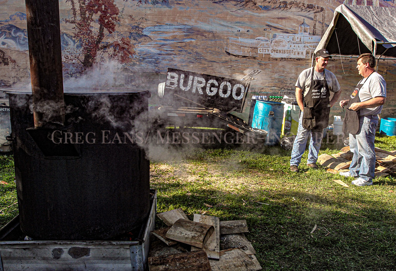 Photo by Greg Eans, Messenger-Inquirer.com/geans@messenger-inquirer.com<br /> <br /> John Mattingly, left, and Russ Hayden, talk together while watching over kettles of boiling mutton in the Blessed Mother cooking team area on Second Street during the 39th annual International Bar-B-Q Festival in Owensboro, Ky.