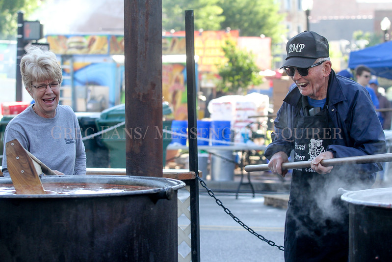 Photo by Greg Eans, Messenger-Inquirer.com/geans@messenger-inquirer.com<br /> <br /> Sandra Thomas, left, and her father in-law, Billy Thomas, laugh together as they stir burgoo in large kettles for the Blessed Mother cooking during the 39th annual International Bar-B-Q Festival in Owensboro, Ky.