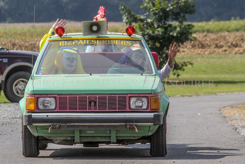Photo by Greg Eans, Messenger-Inquirer.com/geans@messenger-inquirer.com<br /> <br /> Clowns from the Rizpah Shriners make their way though the Livermore, Ky. RV Park, waving to the crowd during the Livermore Fall-Fest.