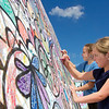 "Photo by Greg Eans, Messenger-Inquirer.com/geans@messenger-inquirer.com<br /> <br /> Anna Morgan Hendrix, 9, foreground, and Elizabeth Wright, 9, both from Owensboro, color together on the ""Coloring Wall"" set up at the East Bridge Art & Music Festival in Owensboro, Ky. The coloring project was a community effort of those attending the festival."