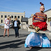 "Photo by Greg Eans, Messenger-Inquirer.com/geans@messenger-inquirer.com<br /> <br /> Cyndi Storm shows off her ""Genie on a Flying Carpet"" costume while competing in the Wax Works employee's Halloween contest in the parking lot of the business on 3rd Street. Employees at the company dress up each year for Halloween and parade in the parking lot to be judged for their creativity.  Storm won Best Overall costume."