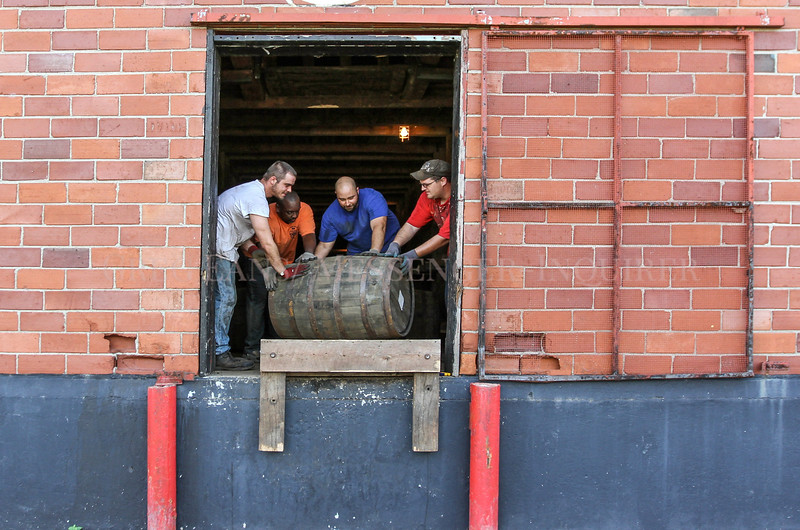 Photo by Greg Eans, Messenger-Inquirer.com/geans@messenger-inquirer.com<br /> <br /> Austin Yates, from left, Evans Dodson, Bobby Babb and Byron Sandefur roll a barrel of bourbon into rickhouse D at the new O.Z. Tyler Distillery in Owensboro, Ky. The distillery has begun offering tours and added a gift shop.