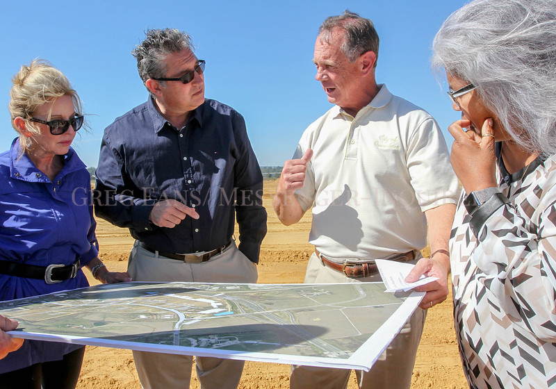 Photo by Greg Eans, Messenger-Inquirer.com/geans@messenger-inquirer.com<br /> <br /> Commissioner Deborah May Nunley, from left, Mayor Pro Tem Jeff Sanford, City Manager Bill Parrish and Commissioner Pam Smith-Wright look over a rendering of the site plan of the Gateway Commons-Kentucky 54 tax increment financing district construction site during a bus tour of city projects.