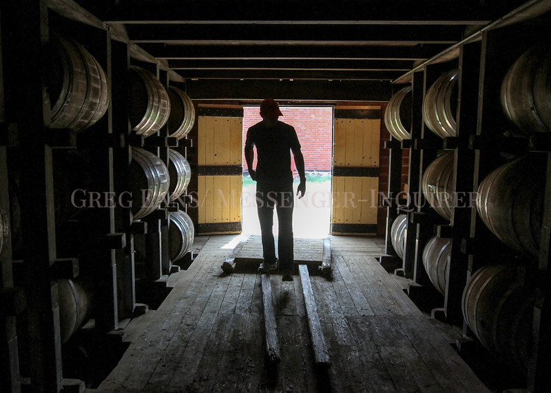 Photo by Greg Eans, Messenger-Inquirer.com/geans@messenger-inquirer.com<br /> <br /> Will Myers, production supervisor at O. Z. Tyler Distillery, walks through a rick house on the company's property in Owensboro, Ky.