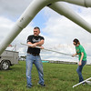 Photo by Greg Eans, Messenger-Inquirer.com/geans@messenger-inquirer.com<br /> <br /> Byron Gish, left, and Jessica Roberson with Harns, Hooks and Feathers out of Calhoun, work at putting together a tent for their vendor booth they will work out of at the eighth annual Big O Music Fest on at Reid's Orchard in Owensboro, Ky.