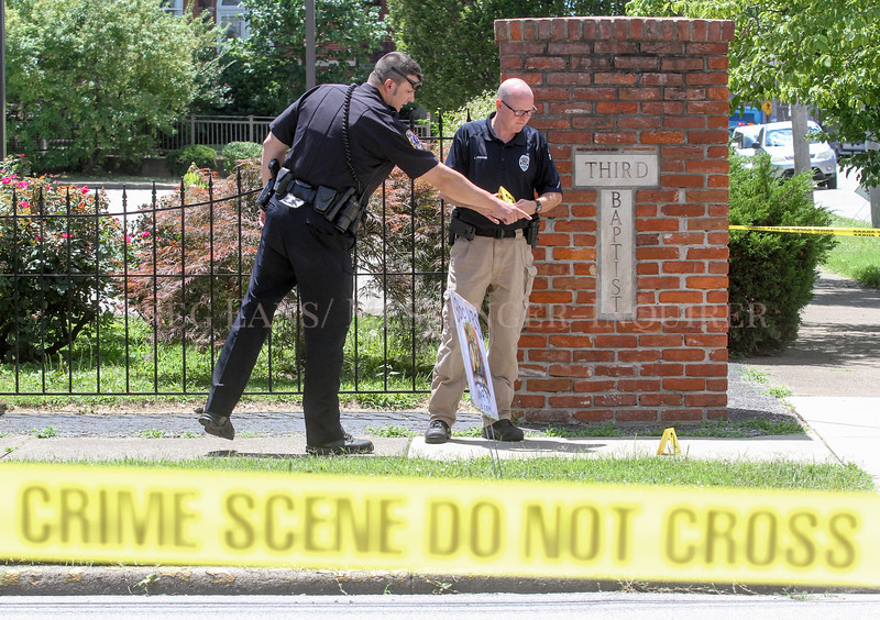 Owensboro Police Officer Brooke Borregard, left, works to investigate and collect evidence with evidence collection supervisor Jim Parham after an altercation that led to a shooting at the 500 block of East 5th Street on June 19, 2017, in Owensboro, Ky. (Greg Eans/The Messenger-Inquirer via AP)
