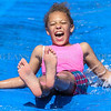 KeShaunia Green, 9, a second grade student at Sorgho Elementary School, slides down a Slip 'N Slide tarp as her class takes part in the school's Primary Water Day on Tuesday, May 16, 2017, in Owensboro, Ky. The school was celebrating the end of the year with events throughout the week, including a Field Day, a fifth grade promotion day and a Celebration Assembly. (Greg Eans/The Messenger-Inquirer via AP)