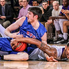 Photo by Greg Eans, Messenger-Inquirer.com/geans@messenger-inquirer.com<br /> <br /> Kentucky Wesleyan's Sam Williams, right, and Ohio Valley University's Kyle Mitchell tie up the ball during action at the Owensboro Sportscenter.