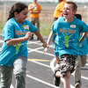 Alisa Sanchez, left, and Hunter Watson, students at Dixon Elementary School, race each other in the 100 meter run while participating in the annual McLean County Spring Games on Friday, April 14, 2017, in Calhoun, Ky. Students from 13 schools in McLean, Daviess, Hancock, Webster, Muhlenberg and Ohio Counties participated in the event which was held on the track at McLean County High School. (Greg Eans/The Messenger-Inquirer via AP)