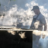 Photo by Greg Eans, Messenger-Inquirer.com/geans@messenger-inquirer.com<br /> <br /> John Mattingly with the Blessed Mother cooking team watches over boiling kettles of mutton during the 39th annual International Bar-B-Q Festival in Owensboro, Ky.