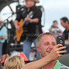 Photo by Greg Eans, Messenger-Inquirer.com/geans@messenger-inquirer.com<br /> <br /> A fan takes a photo with a cellphone during the eighth annual Big O Fest in Owensboro, Ky.