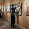"Photo by Greg Eans, Messenger-Inquirer.com/geans@messenger-inquirer.com<br /> <br /> Aaron Walker, right, a staff assistant at the Owensboro Museum of Fine Art, right, hangs a mixed media painting titled ""Pond"" by Louisville artist Dennis Mader as he helps praparator Rocky Cecil, left, install the Owensboro Art Guild's 55th Annual Juried Exhibition at the museum in Owensboro. Ky. The exhibition is scheduled at the museum, Feb. 25 to April 14."