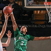Photo by Greg Eans, Messenger-Inquirer.com/geans@messenger-inquirer.com<br /> <br /> Meade County's James Baker blocks a shot by Edmonson County's J. T. Vincent during Boys 3rd Region Basketball Tournament action at the Owensboro Sportscenter. Meade won the game 54-43.