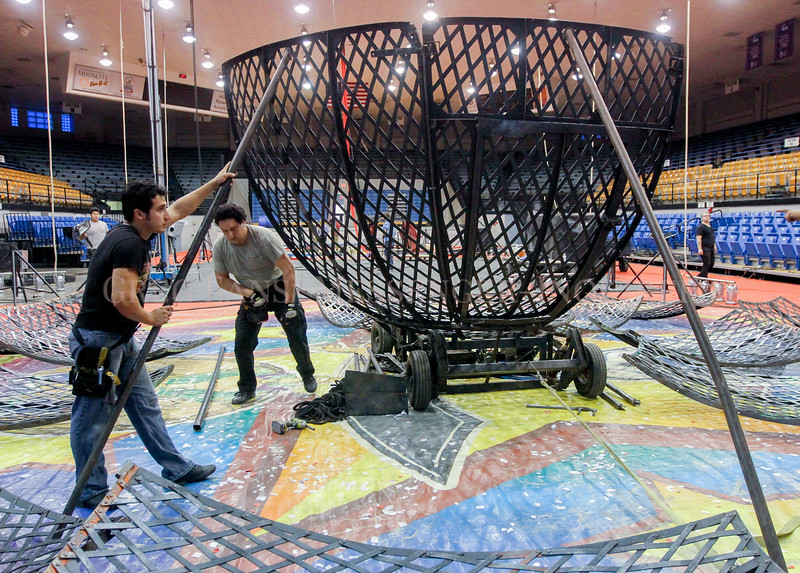 Photo by Greg Eans, Messenger-Inquirer.com/geans@messenger-inquirer.com<br /> <br /> Saturn Garcia, left, and his brother, Bardo Garcia work at putting together the Globe of Steel inside the Owensboro Sportscenter to prepare for the Rizpah Shriner's Circus.  The Globe of Steel is a stunt act where a daredevil motorcyclist performs stunts inside the globe.