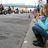 Photo by Greg Eans, Messenger-Inquirer.com/geans@messenger-inquirer.com<br /> <br /> Hadley Stearsman, right, of Owensboro, watches with her family as the city's Veterans Day Parade passes by on East Second Street.