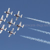 Photo by Greg Eans, Messenger-Inquirer.com/geans@messenger-inquirer.com<br /> <br /> The Canadian Forces Snowbirds speed past Smothers Park in Downtown Owensboro during the Owensboro Air Show.