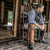 Photo by Greg Eans, Messenger-Inquirer.com/geans@messenger-inquirer.com<br /> <br /> Storyteller Phillip Williams of Elizabethtown wears  1790-1840 period clothing and sits outside of a cabin to wait for school children to come hear his stories during Pioneer Days at the James Lambert Pioneer Village at Yellow Creek Park.