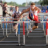 Photo by Greg Eans, Messenger-Inquirer.com/geans@messenger-inquirer.com<br /> <br /> Daviess County Junior Drew Cockrell leaps the final hurdle to finish first in the boys 110 meter hurdle event during the City-County Championships at Colonel Stadium in Henderson.