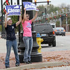 Photo by Greg Eans, Messenger-Inquirer.com/geans@messenger-inquirer.com<br /> <br /> Jasmine Duncan, left, of Bowling Green, and Jody Mauro of Owensboro yell at passing motorists with State Representative Jim Glenn election signs at the corner of W. Second Street and Frederica Street in Owensboro.