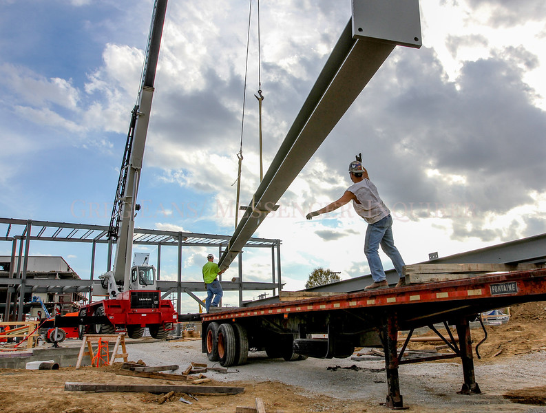 Photo by Greg Eans, Messenger-Inquirer.com/geans@messenger-inquirer.com<br /> <br /> Justin Pounds, left, and Tim King with G & M Steel out of Rockport, IN, unload vertical steel beams from a trailer while working on the construction of the International Bluegrass Music Museum at East Second and Frederica Streets in Owensboro, Ky.